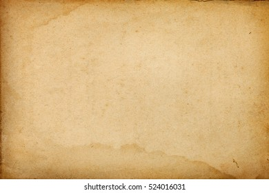 Brown vintage paper abstract messy background with stained borders