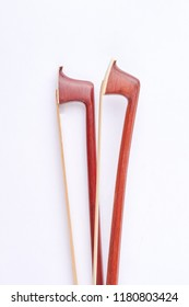 Brown violin fiddle stick, top view. Fiddle stick for classical violin over white background. Wooden violin bow.