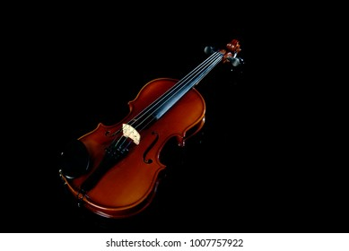 brown violin on a black background. Violin on isolation in black. Violin in full size.