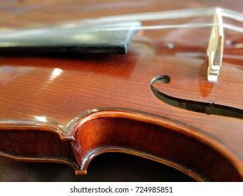 brown violin on brown cloth