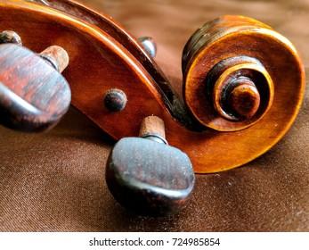 brown violin scroll