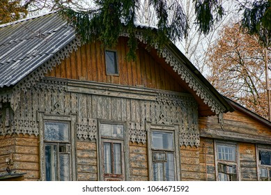 Brown Wall Of An Old House With Windows And Veranda In The Courtyard With  Trees