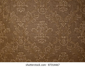 Brown wallpaper background with floral motives