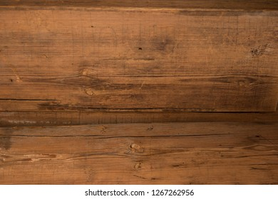 Brown walnut wood texture, old rustic surface with skratches