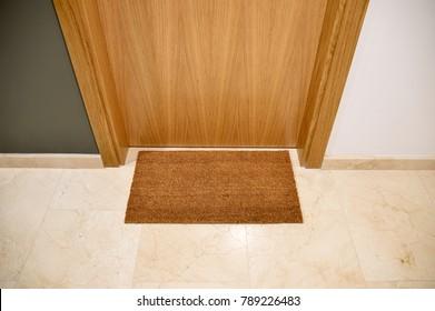 Brown welcome mat at front door