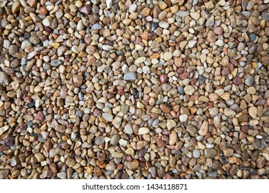 Brown white and blue pebble texture with various sizes.