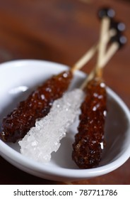 brown and white rock candy, rock candy, rock sugar on wood stick, crystal sugar on stick, sugar candy, rock candy