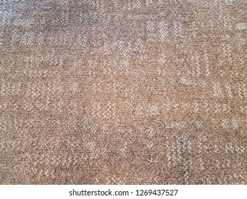 brown and white rug or carpet textile