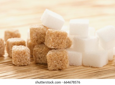 brown and white sugar on wooden background