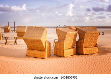 brown wicker beach chairs on the sunny beach