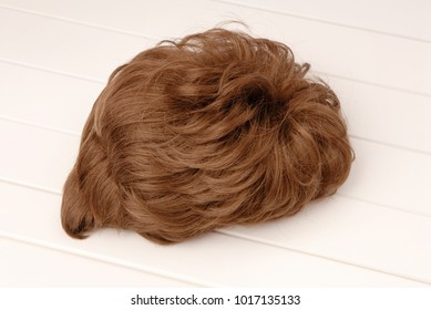 brown wig is on white background, isolated curly-haired haircut wig