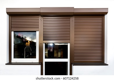 Brown window blinds outside the home.