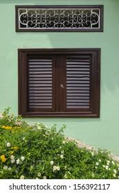 Brown window on green, Las Pinas, Guayaquil, Ecuador
