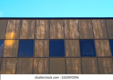 brown windows steel building wall modern skyscraper