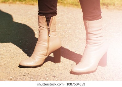 Brown woman's boot, light leather shoes, outdoor