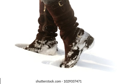 Brown women's shoes covered by snow in the winter.