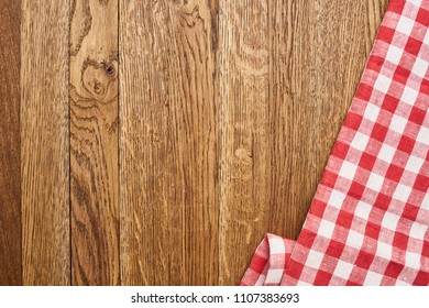 brown wood background and checkered fabric