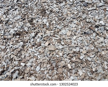brown wood chips or barkdust or mulch on the ground