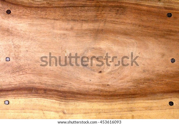 Brown wood flat background and nail