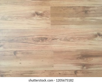 Brown wood laminate floor varnish interior in modern home design. Wooden parquet background, Wood texture for design and decoration.
