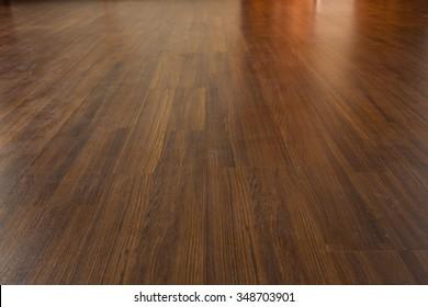 brown wood laminate floor varnish in modern home