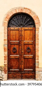 Brown wood old door in the centre of San Gimignano, Tuscany, Italy.