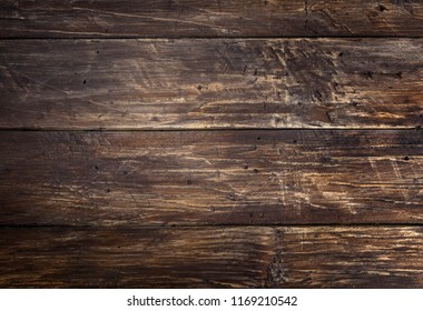 Brown wood scratched desk board table top texture. Abstract background, text space, empty template.