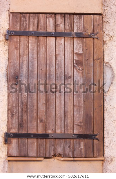 brown wood shutter in the street