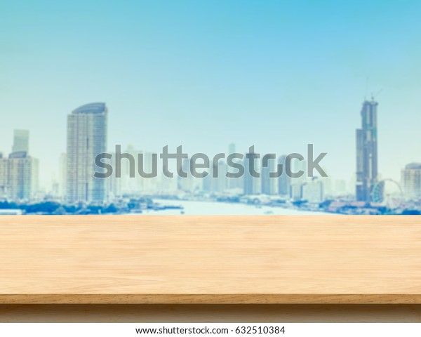 Brown wood table top and black marble base with city building landscape view, Mock up template for display or montage of your product, Urban concept background