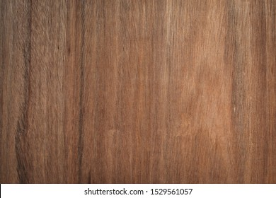 Brown wood texture background coming from natural tree. Abstract wooden panel with beautiful patterns.Background for interior design.