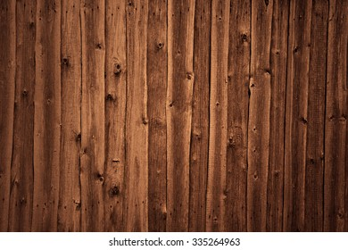 A brown wood texture made of panels which can be used as background.
