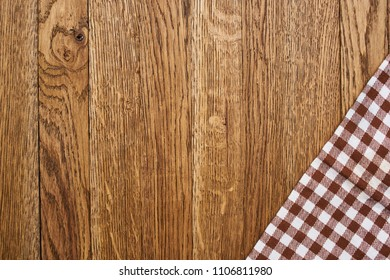 brown wooden background and checkered napkin