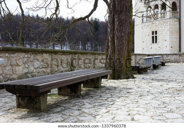 Enjoyable Brown Wooden Benches Near Medieval Stone Stock Photo Edit Machost Co Dining Chair Design Ideas Machostcouk