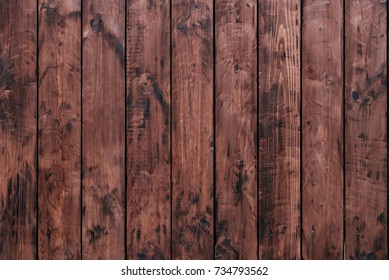 Brown, wooden board fence. Dark vintage wooden boards. Backgrounds and textures fence painted. Front view. Attract a beautiful vintage.