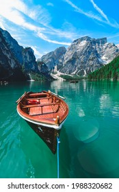 brown wooden boat in clear blue water of mountain lake. copy space