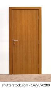 Brown wooden closed door inside modern interior