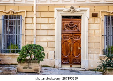 Brown wooden door in Aix-en-Provence, France.