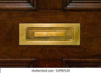 Brown Wooden Door Closed Mailslot Golden Metal Closeup Texture Post