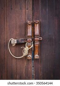 Brown wooden door and wooden lock