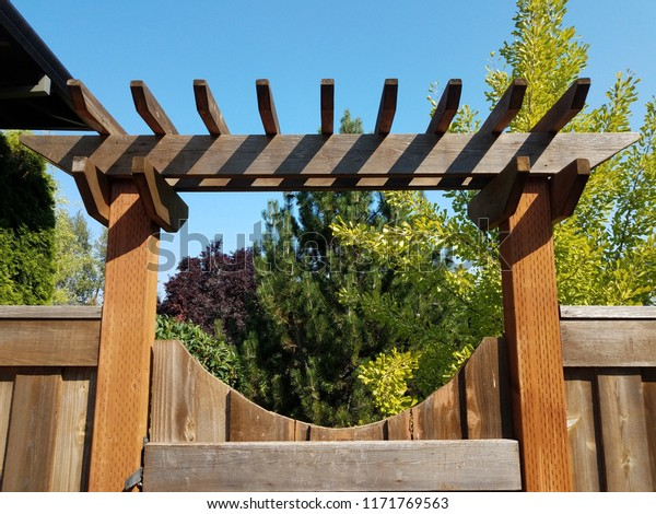 brown wooden fence and gate with lattice