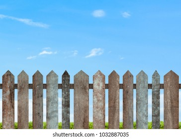 Brown wooden fence on blue sky background with parallel plank old. Object with clipping path