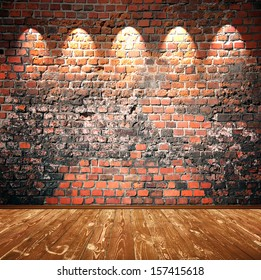 brown wooden floor and brick wall