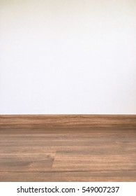 Brown wooden floors and white wall. Wooden floors background