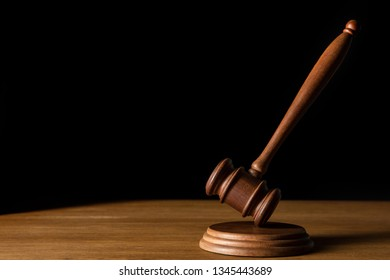 brown wooden gavel isolated on black with copy space