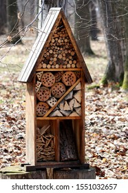 Brown wooden insect hotel in the park