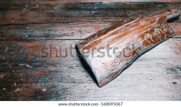 Brown wooden serving board on the same color table. Top angle view. Recipe frame
