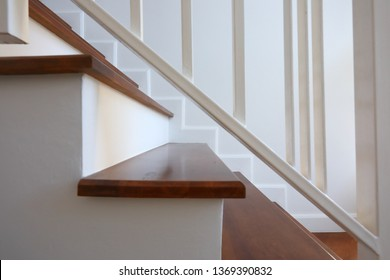 brown wooden stair and white wall in modern residential house