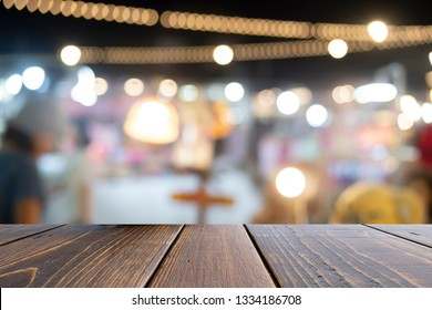 Brown wooden table in front blurred bokeh background, presentation and template