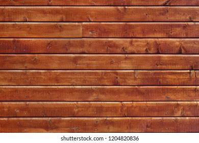 Brown wooden wall of a new filleting house in Norway.