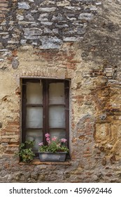 Brown wooden window in an old Italian house.